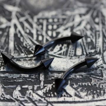 Czarny stalowy anodyzowany banan ze stożkami